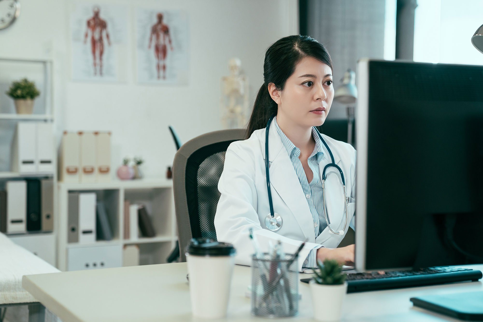 doctor on computer woman