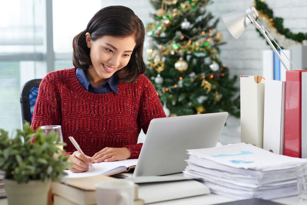 holiday planning woman at computer